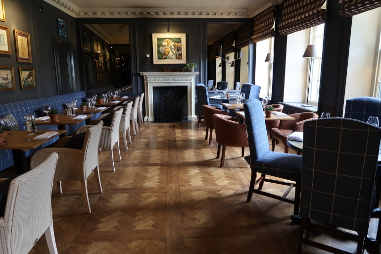 The Close Hotel in Tetbury, Dark and contemporary  interiors styled with spring flowers. A cool cotswold hotel for lunch drinks or dinner.