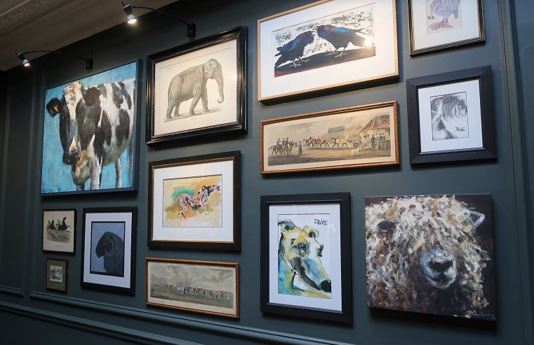 gallery wall art at the Close hotel. Great gallery wall of animals in the bar of this Tetbury Hotel.